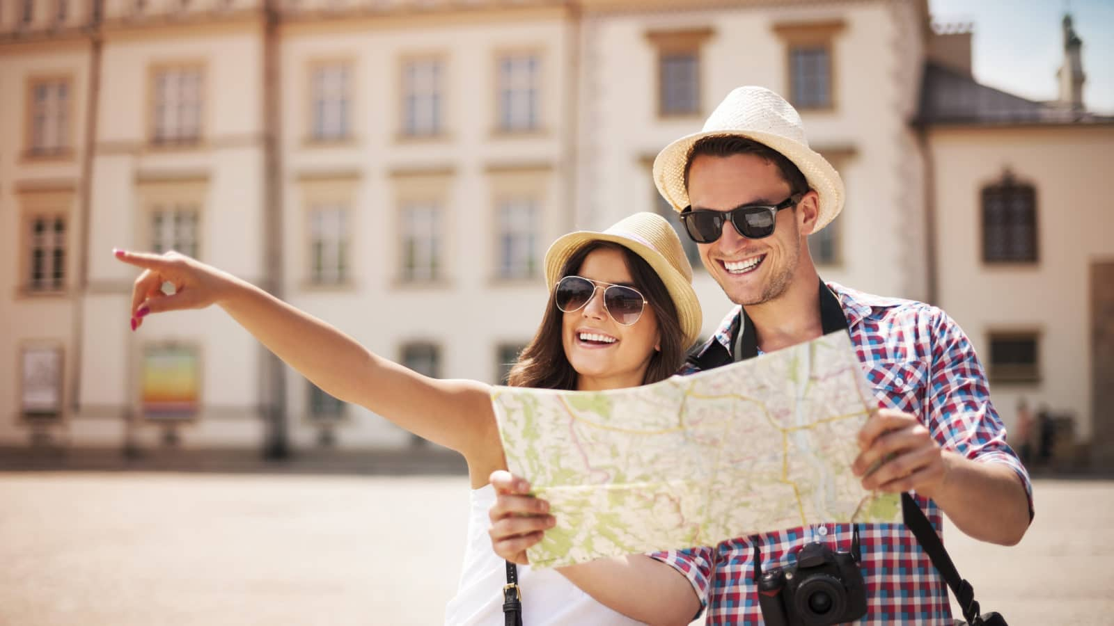 Couple tourists holding map